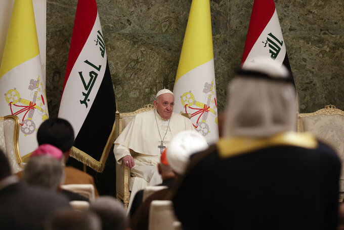 Pope Francis meets authorities and civil society at Baghdad's Presidential Palace, Iraq, Friday, March 5, 2021. Pope Francis has arrived in Iraq to urge the country's dwindling number of Christians to stay put and help rebuild the country after years of war and persecution, brushing aside the coronavirus pandemic and security concerns. (AP Photo/Andrew Medichini)