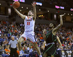 Virginia's guard Ty Jerome (11) shoots past Marshall's C.J. Burks (14) during the second half of an NCAA college basketball game on Monday, Dec. 31, 2018, in Charlottesville, Va. Virginia beat Marshall 100-64. (AP Photo/Zack Wajsgras)