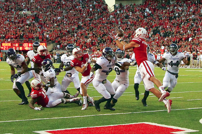 Fantastic finishes make Wildcats, Huskers improbable rivals