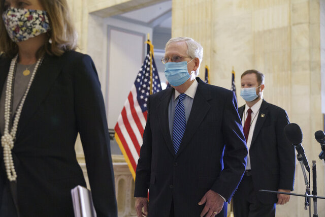 Senate Majority Leader Mitch McConnell, R-Ky., arrives as Senate Republicans hold leadership elections, on Capitol Hill in Washington, Tuesday, Nov. 10, 2020. (AP Photo/J. Scott Applewhite)