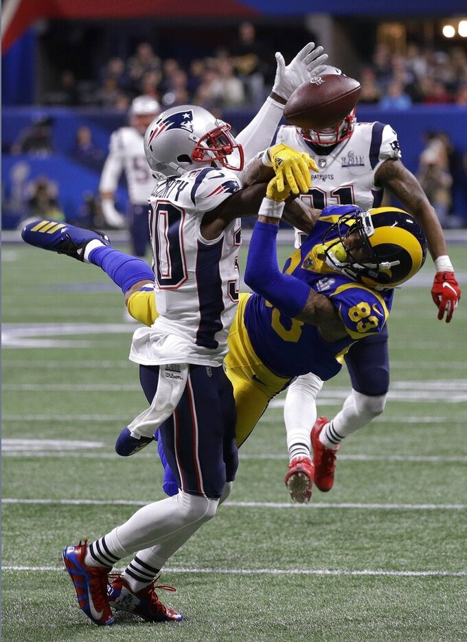 New England Patriots' Jason McCourty, left, breaks up a pass intended for Los Angeles Rams' Josh Reynolds during the first half of the NFL Super Bowl 53 football game Sunday, Feb. 3, 2019, in Atlanta. (AP Photo/David J. Phillip)