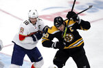 Boston Bruins defenseman Zdeno Chara (33) takes a stick across the shoulders from Florida Panthers center Aleksander Barkov (16) during the third period of an NHL hockey game in Boston, Tuesday, Nov. 12, 2019. (AP Photo/Charles Krupa)