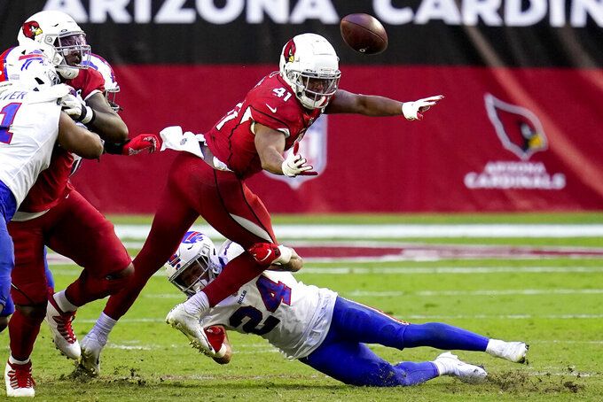 Arizona Cardinals running back Kenyan Drake (41) fumbles the ball as Buffalo Bills cornerback Taron Johnson (24) makes the hit during the second half of an NFL football game, Sunday, Nov. 15, 2020, in Glendale, Ariz. The Bills recovered the ball. (AP Photo/Ross D. Franklin)