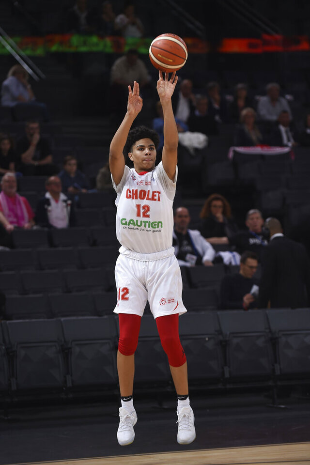 File-This April 22, 2017, file photo shows Cholet's Killian Hayes shooting during the French Cup under-17 final between Cholet and Chalon-sur-Saone in Paris.  Most NBA fans are just now learning the name Killian Hayes. The 19-year-old French-American point guard will likely be a top 5 pick in Wednesday night's draft. The shifty 6-foot-5 lefty is among several international prospects that will be drafted, including Deni Avdija, Israel; Théo Maledon, France; Leandro Bolmaro, Argentina; and Aleksej Pokusevski, Serbia. (AP Photo, File)