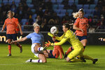 Manchester City's Pauline Bremer, left, scores against Everton during the Women's Super League match at the Academy Stadium, Manchester, England, Saturday Jan. 11, 2020. (Anthony Devlin/PA via AP)