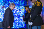 United Nations Secretary General Antonio Guterres, left, pays his respects during a wreath laying ceremony at United Nations headquarters, Friday March 15, 2019, for U.N. personnel that were aboard Ethiopian Airlines Flight ET302. At least 21 U.N. personnel were among the 157 people from 35 countries who died Sunday morning when an Ethiopian Airlines Boeing 737 MAX 8 jetliner crashed shortly after takeoff from Addis Ababa en route to Nairobi, Kenya. (United Nations Photo by Manuel Elias via AP)