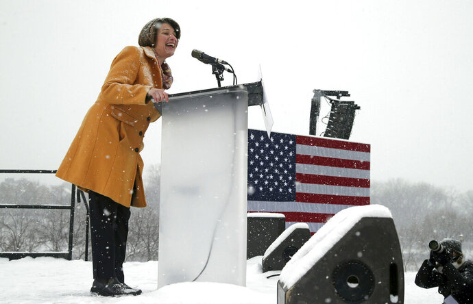 Democratic Sen. Amy Klobuchar addresses a snowy rally where she announced she is entering the race for president Sunday, Feb. 10, 2019, at Boom Island Park in Minneapolis. (AP Photo/Jim Mone)