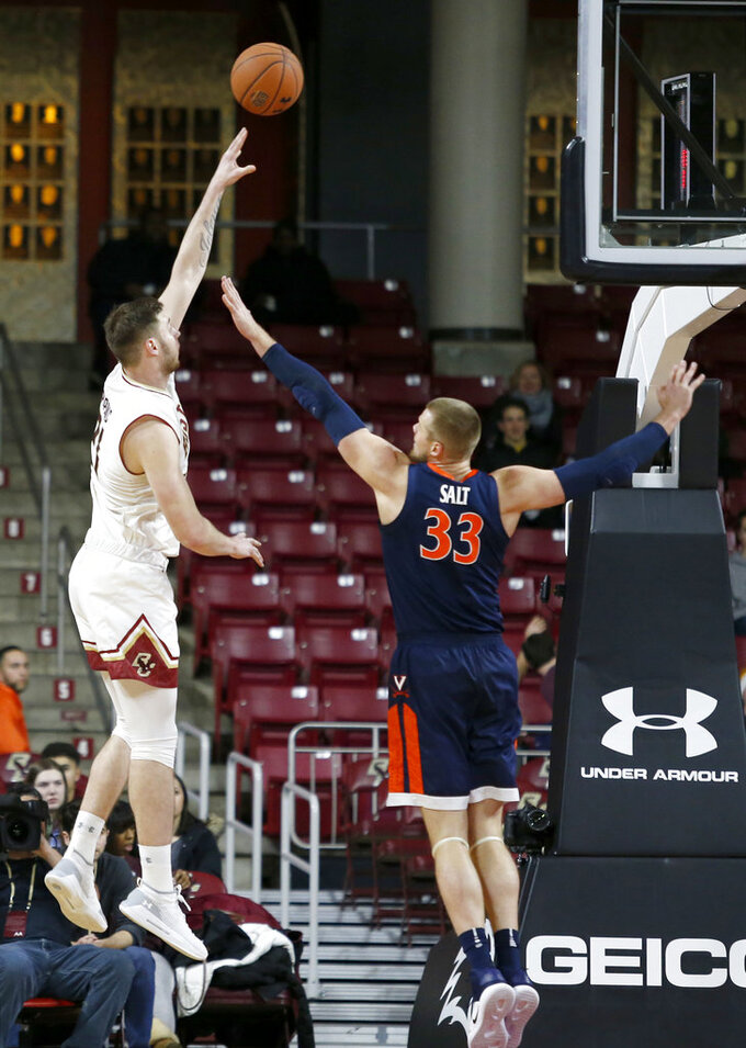 Boston College forward Nik Popovic (21) shoots over Virginia center Jack Salt (33) during the first half of an NCAA basketball game Wednesday, Jan. 9, 2019, in Boston. (AP Photo/Mary Schwalm)