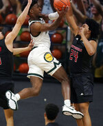 Michigan State forward Aaron Henry makes a layup as Rutgers guard Ron Harper Jr. (24) defends during the first half of an NCAA college basketball game, Tuesday, Jan. 5, 2021, in East Lansing, Mich. (AP Photo/Carlos Osorio)