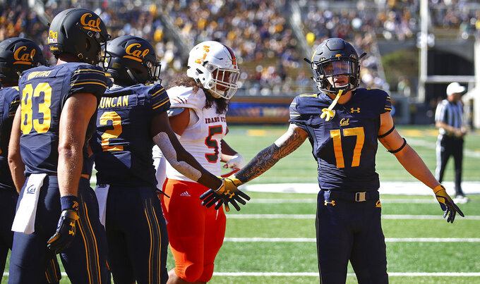 California's Jordan Duncan (2) celebrates with Vic Wharton III after scoring a touchdown against Idaho State during the first half of an NCAA college football game Saturday, Sept. 15, 2018, in Berkeley, Calif. (AP Photo/Ben Margot)