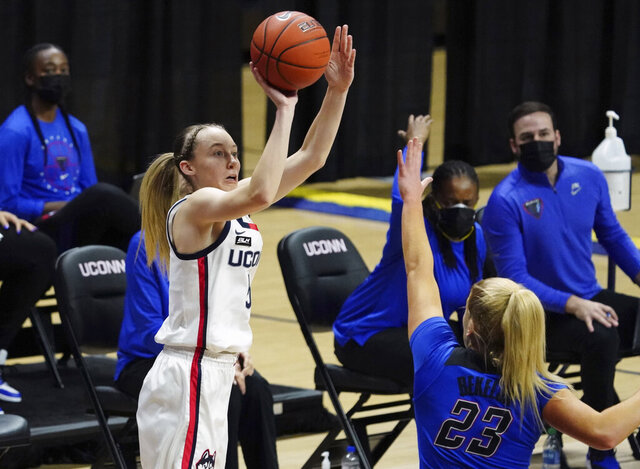 Connecticut guard Paige Bueckers (5) shoots over DePaul guard Dee Bekelja (23) in the first half of an NCAA college basketball game Tuesday, Dec. 29, 2020, in Storrs, Conn. (David Butler II/Pool Photo via AP)