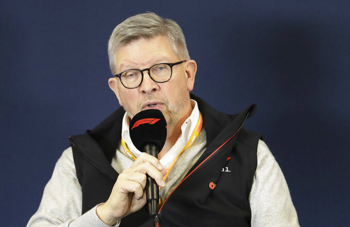 "FILE  - In this Thursday, Oct. 31, 2019 file photo,  F1 manager director of motorsports Ross Brawn speaks during a news conference at the Formula One U.S. Grand Prix auto race at the Circuit of the Americas, in Austin, Texas. Formula One hopes to finally start the season with a double-header in the naturally isolated environment around the venue for the Austrian Grand Prix. Brawn says this is a ""real consideration"" so long as iron-tight safety regulations are met. (AP Photo/Darron Cummings, File)"