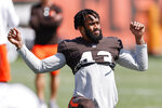 Cleveland Browns strong safety John Johnson warms up during NFL football practice Wednesday, Sept. 1, 2021, in Berea, Ohio. (AP Photo/Ron Schwane)