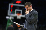 Boston Celtics head coach Brad Stevens pauses as he draws up a play during the first quarter of an NBA basketball game against the Brooklyn Nets in Boston, Monday, Jan. 7, 2019. (AP Photo/Charles Krupa)