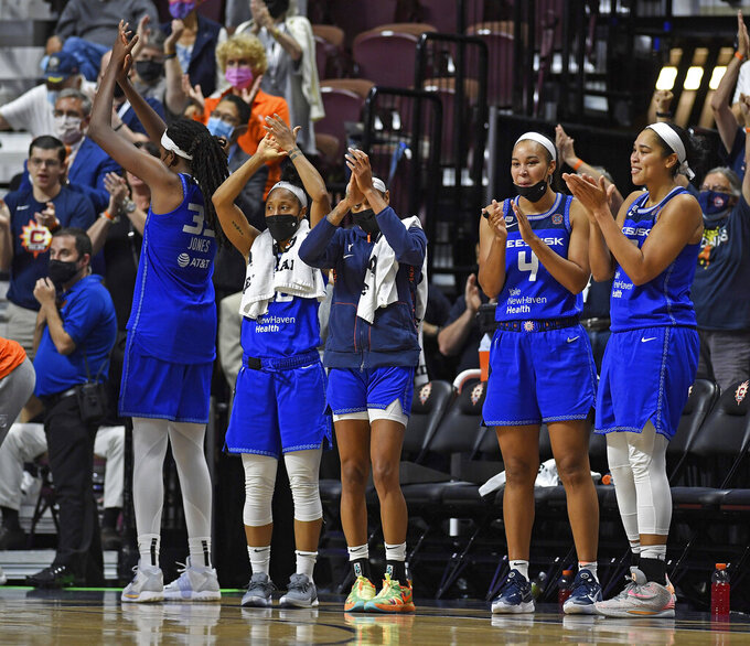 Connecticut Sun players on the bench applaud as time expires on their win over the Atlanta Dream in a WNBA basketball game Sunday, Sept. 19, 2021, in Uncasville, Conn. (Sean D. Elliot/The Day via AP)