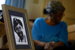 CORRECTS NAME OF BATTALION - World War II veteran Maj. Fannie Griffin McClendon shows an image of herself during her time in the military, at her home Thursday, June 10, 2021, in Tempe, Ariz. McClendon had a storied history as a member of the 6888th Central Postal Directory Battalion that made history as being the only all-female, black unit to serve in Europe during World War II. (AP Photo/Matt York)