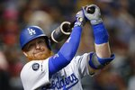 FILE - In this Aug. 29, 2019, file photo, Los Angeles Dodgers' Justin Turner warms up as he waits to bat against the Arizona Diamondbacks during the third inning of a baseball game in Phoenix. Turner is among older players who might see time at designated hitter if the National League uses it this season. (AP Photo/Ross D. Franklin, File)