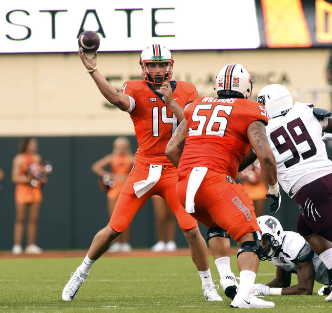 Cornelius throws 5 TDs in 1st start; Oklahoma St. rolls