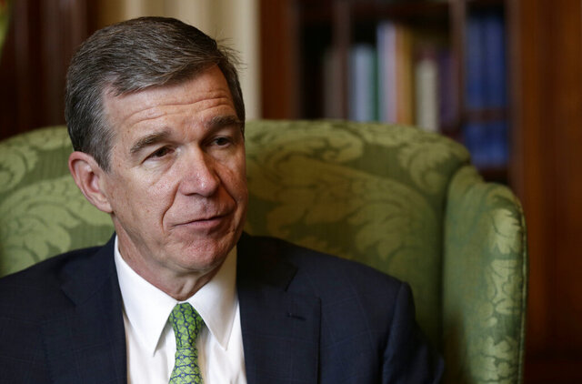 FILE - In this Wednesday, Dec. 19, 2018 file photo, North Carolina Gov. Roy Cooper responds during an interview at the Governor's mansion in Raleigh, N.C. Many of North Carolina Democratic Gov. Roy Cooper's lasting achievements in 2019 stem from keeping Republican policies from ever getting implemented. During a year-end interview with The Associated Press on Wednesday, Dec. 18, 2019 Cooper cited successes in recruiting companies and jobs to the state, reducing the number of opioid deaths and moving the state toward cleaner energy during the third year of his term. (AP Photo/Gerry Broome, File)