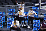 Loyola players celebrate after a score against Illinois during the first half of a college basketball game in the second round of the NCAA tournament at Bankers Life Fieldhouse in Indianapolis Sunday, March 21, 2021. (AP Photo/Mark Humphrey)