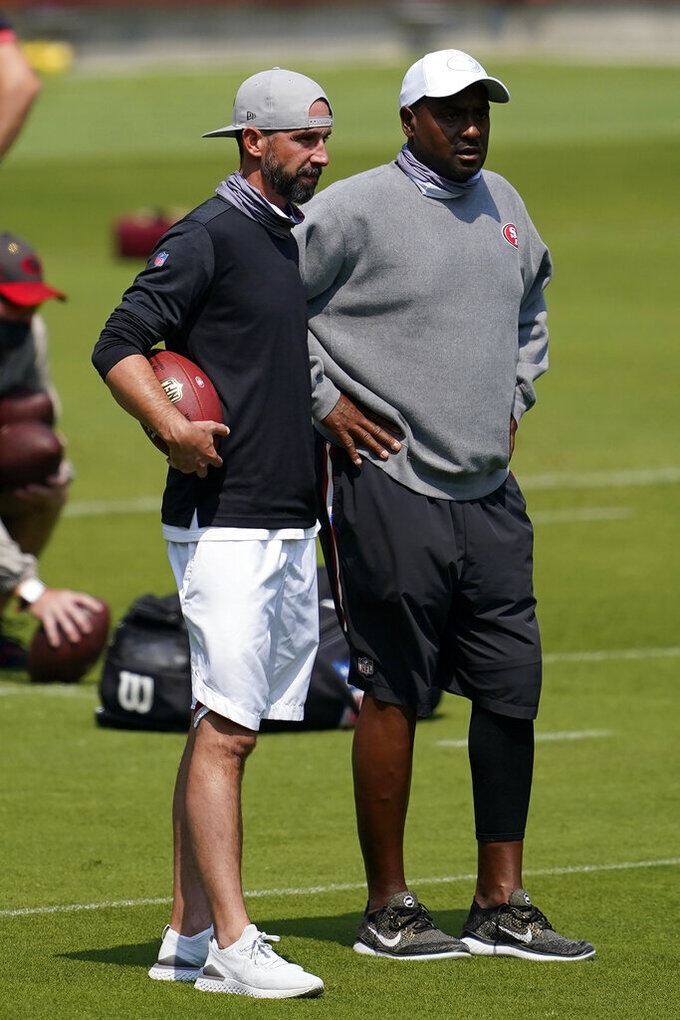 San Francisco 49ers head coach Kyle Shanahan, left, talks with assistant coach Jon Embree during NFL football practice in Santa Clara, Calif., Wednesday, Sept. 2, 2020. (AP Photo/Jeff Chiu, Pool)