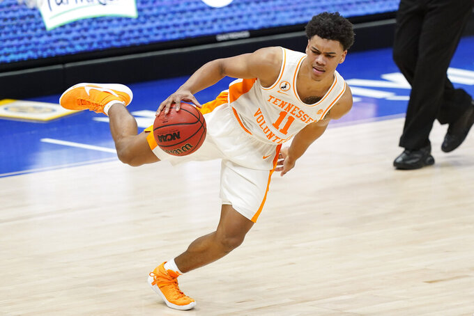 Tennessee's Jaden Springer (11) keeps his balance as he moves the ball against Florida in the second half of an NCAA college basketball game in the Southeastern Conference Tournament Friday, March 12, 2021, in Nashville, Tenn. (AP Photo/Mark Humphrey)