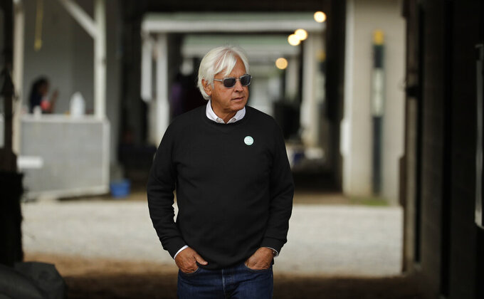 FILE - In this May 1, 2019, file photo, trainer Bob Baffert looks out from his barn before a workout at Churchill Downs in Louisville, Ky. Baffert was suspended for two years by Churchill Downs on Wednesday, Mune 2, 2021, after an additional drug test of Medina Spirit confirmed the presence of the steroid betamethasone in the Kentucky Derby winner's system. (AP Photo/Charlie Riedel, File)