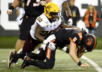 Oregon State quarterback Jake Luton is sacked by Arizona State linebacker Khaylan Kearse-Thomas during the first half of an NCAA college football game in Corvallis, Ore., Saturday, Nov. 16, 2019. (AP Photo/Steve Dykes)