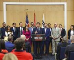 Florida Gov. Ron DeSantis, center, gives his opening remarks flanked by local state delegation members prior to signing legislation that seeks to punish social media platforms that remove conservative ideas from their sites, inside Florida International University's MARC building in Miami on Monday, May 24, 2021. (Carl Juste/Miami Herald via AP)