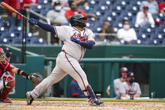 Atlanta Braves' Pablo Sandoval watches his two-run home run during the seventh inning of the second baseball game of the team's doubleheader against the Washington Nationals at Nationals Park, Wednesday, April 7, 2021, in Washington. The Braves won 2-0. (AP Photo/Alex Brandon)