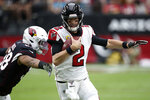 Atlanta Falcons quarterback Matt Ryan (2) scrambles as Arizona Cardinals middle linebacker Jordan Hicks pursues during the first half of an NFL football game, Sunday, Oct. 13, 2019, in Glendale, Ariz. (AP Photo/Ross D. Franklin)