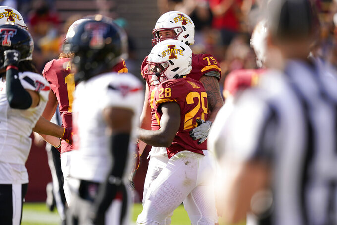 Iowa State running back Breece Hall (28) celebrates with teammates after scoring on a 1-yard touchdown run during the first half of an NCAA college football game against Texas Tech, Saturday, Oct. 10, 2020, in Ames, Iowa. (AP Photo/Charlie Neibergall)