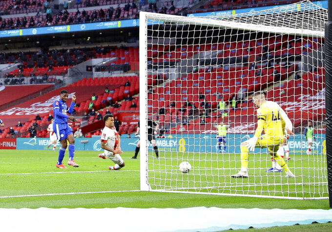 Leicester's Kelechi Iheanacho, left, scores his side's opening goal during the English FA Cup semifinal soccer match between Leicester City and Southampton at Wembley Stadium in London, Sunday, April 18, 2021. (Richard Heathcote/Pool via AP)