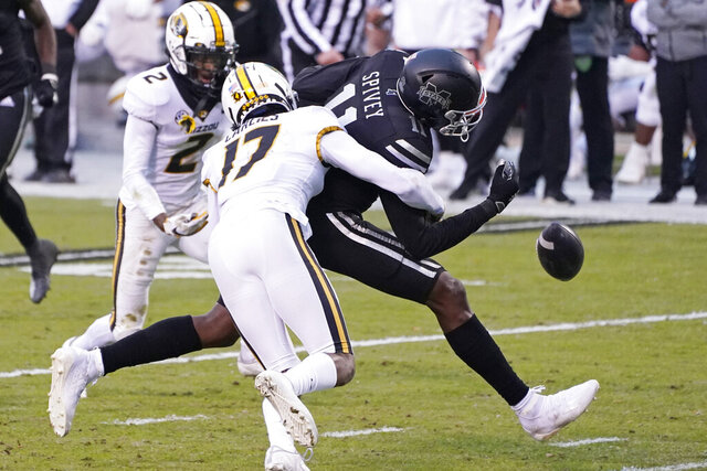 Mississippi State wide receiver Geor'quarius Spivey (11) has the pass knocked away by Missouri defensive back Jaylon Carlies (17) during the first half of an NCAA college football game, Saturday, Dec. 19, 2019, in Starkville, Miss. (AP Photo/Rogelio V. Solis)