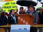 FILE - In this Feb. 7, 2018, file photo, Jeff Tittel, at podium, speaks during a rally of environmentalists against offshore drilling in the Atlantic Ocean in Asbury Park, N.J. On Wednesday, March 24, 2021, Tittel announced his retirement as director of the New Jersey Sierra Club, where he had been the state's highest-profile environmentalist for years. (AP Photo/Wayne Parry, File)