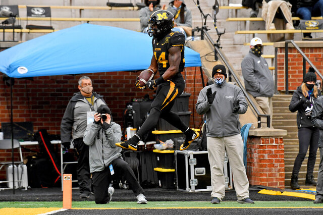 Missouri running back Larry Rountree III celebrates after scoring on a 1-yard run during the first half of an NCAA college football game against Georgia 1Saturday, Dec. 12, 2020, in Columbia, Mo. (AP Photo/L.G. Patterson)