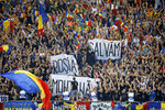 """FILE - In this Friday, Sept. 6, 2013 file photo, Romanian soccer fans hold banners that read """"We Save Rosia Montana"""", protesting against the government's plan to allow Canada's Gabriel Resources to dig for gold, during the World Cup Group D qualifying soccer match between Romania and Hungary in Bucharest, Romania. Rosia Montana, the site of ancient Roman mining galleries in a mountainous western Romanian region and home to Europe's largest gold deposits, an estimated 314 tonnes, which was set to be exploited over a 16-year period by Gabriel Resources, a Canadian mining company that gained concession rights to the area in 1999, was added to UNESCO's World Heritage list Tuesday, July 27, 2021. (AP Photo/Vadim Ghirda, File)"""