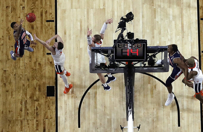 Auburn's J'Von McCormick (12) takes a shot against Virginia's Kyle Guy (5) during the second half in the semifinals of the Final Four NCAA college basketball tournament, Saturday, April 6, 2019, in Minneapolis. (AP Photo/Jeff Roberson)