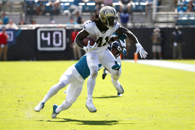 New Orleans Saints running back Alvin Kamara (41) runs against the Jacksonville Jaguars during the first half of an NFL football game, Sunday, Oct. 13, 2019, in Jacksonville, Fla. (AP Photo/Stephen B. Morton)
