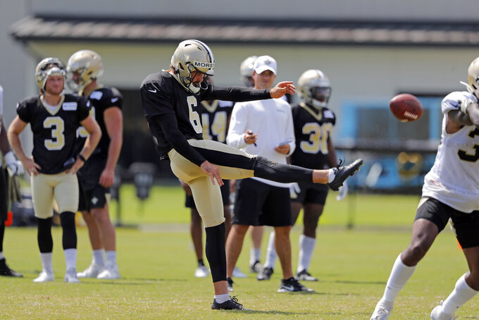 FILE - In this Aug. 1, 2019, file photo, New Orleans Saints' Thomas Morstead punts during the NFL football team's training camp in Metairie, La. Between Morstead placing punts just short of opponents' goal lines and diminutive returner Deonte Harris deftly darting away from tacklers, the Saints like the way their special teams have influenced the outcomes of games. (AP Photo/Gerald Herbert, File)