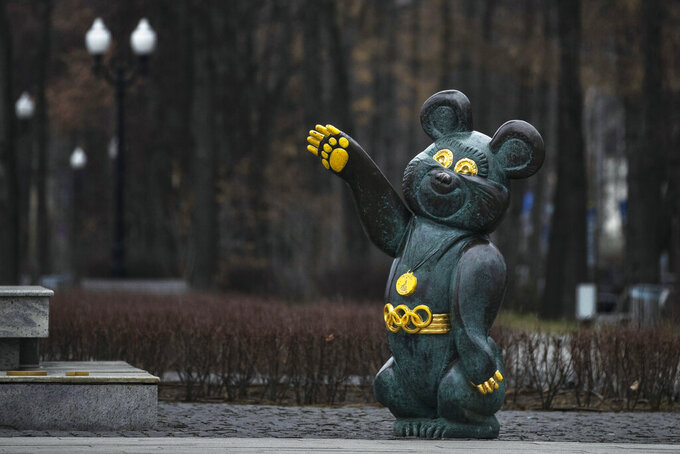 A monument to Misha the Bear, the mascot of the Moscow 1980 Olympic Games, in a park in Moscow, Russia, Monday, Dec. 9, 2019. The World Anti-Doping Agency has banned Russia from the Olympics and other major sporting events for four years, though many athletes will likely be allowed to compete as neutral athletes. (AP Photo/Pavel Golovkin)