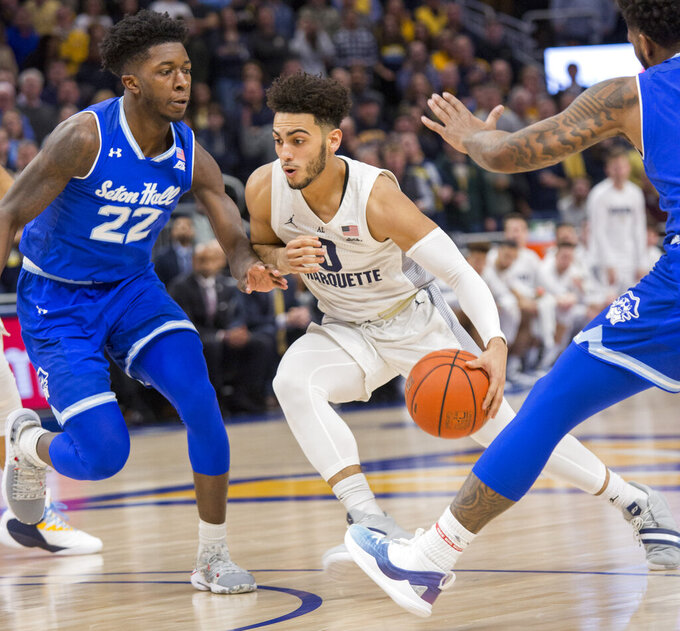 Howard's 26 help No. 21 Marquette hold off Seton Hall 70-66