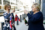 From left, Norway's Minister of Trade and Industry Iselin Nybo and Prime Minister Erna Solberg, toast, after a press conference on the status of free trade negotiations with the United Kingdom, in Oslo, Friday, June 4, 2021. Non-EU member Norway has reached a post-Brexit free trade deal with its greatest trading partner, Britain, that left the bloc last year following a 2016 referendum. Some of the differences included the import to Norway of agricultural goods such as meat and cheese, and fish exports to Britain. Norway has access to the EU's vast common market and most goods are exempt from duties. However, the obstacle-free trading with Britain ended in late 2020. (Gorm Kallestad/NTB via AP)