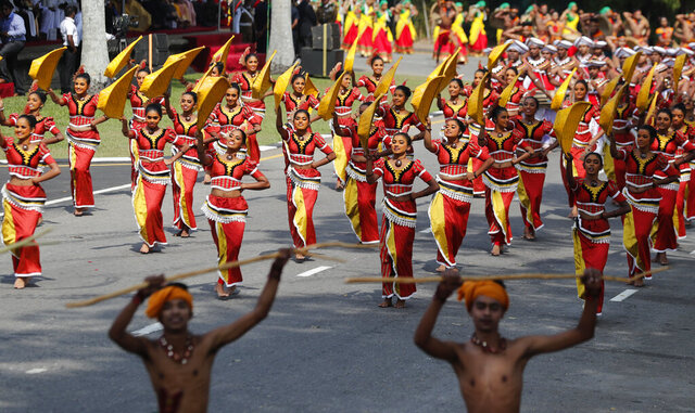 Sri Lankan traditional dancers perform during an event to mark the anniversary of country's independence from British colonial rule in Colombo, Sri Lanka, Tuesday, Feb. 4, 2020. (AP Photo/Eranga Jayawardena)
