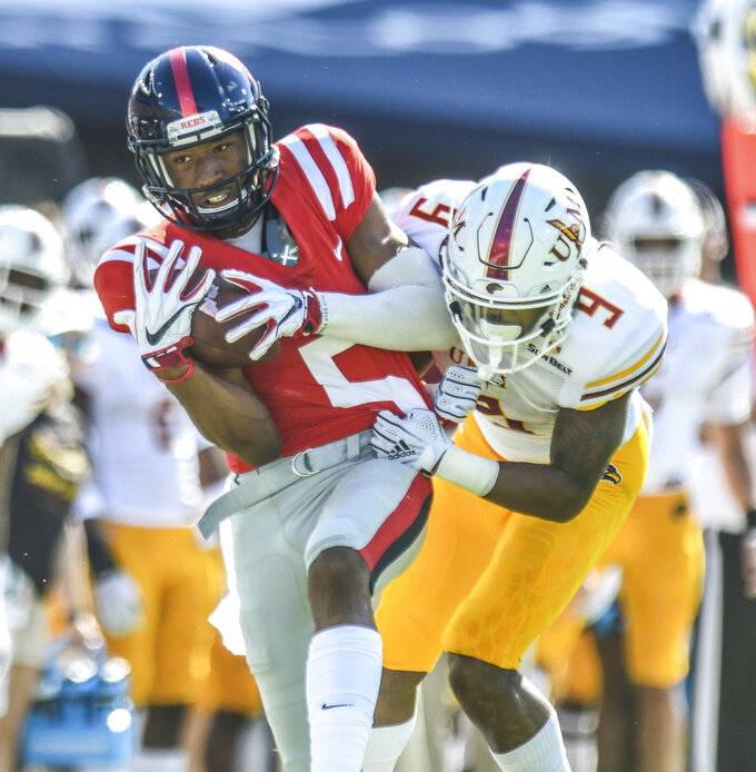 Mississippi wide receiver DaMarkus Lodge (5) makes a catch against Louisiana Monroe cornerback Marcus Hubbard (9) during an NCAA college football game, Saturday, Oct. 6, 2018, at Vaught-Hemingway Stadium in Oxford, Miss. (Bruce Newman/The Oxford Eagle via AP)