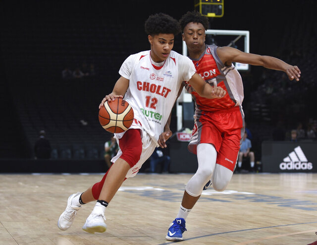 FILE - In this April 22, 2017, file photo, Cholet's Killian Hayes, left, drives against an unidentified Chalon-sur-Saone player during the French Cup under-17 final in Paris on April 22, 2017. Hayes was selected by the Detroit Pistons in the NBA draft Wednesday, Nov. 18, 2020. (AP Photo, Fil)