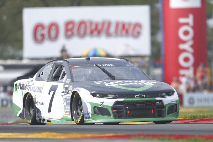 Corey LaJoie drives through the Bus Stop during a NASCAR Cup Series auto race in Watkins Glen, N.Y., on Sunday, Aug. 8, 2021. (AP Photo/Joshua Bessex)