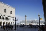 FILE- In this June 2, 2019 file photo, a cruise ship passes by St. Mark's Square in Venice, Italy.  UNESCO's World Heritage Committee is debating Thursday, July 22, 2021, whether Venice and its lagoon environment will be designated a world heritage site in danger due to the impact of over-tourism alongside the steady decline in population and poor governance. (AP Photo/Luca Bruno, file)
