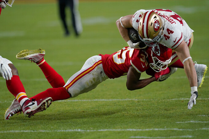 Kansas City Chiefs Charvarius Ward tackles San Francisco 49ers Kyle Juszczyk during the second half of the NFL Super Bowl 54 football game Sunday, Feb. 2, 2020, in Miami Gardens, Fla. (AP Photo/David J. Phillip)