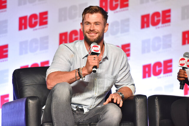 FILE - In a Sunday, Oct. 13, 2019 file photo, Chris Hemsworth participates during a Q&A panel on day three at the Ace Comic-Con  in Rosemont, Ill. Elton John and Chris Hemsworth are among the celebrities donating big bucks to help aid the efforts for the engulfing wildfires in Australia. (Photo by Rob Grabowski/Invision/AP, File)